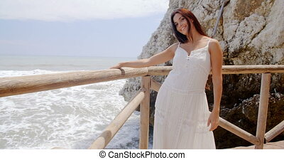 Lady Holding at Beach Railing with Air Blown Hair - Smiling...