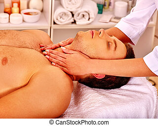 Man getting facial massage . - Man getting facial and neck...