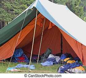 tent of boy scout camp with backpacks and sleeping bags...