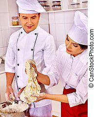 Woman man in chef hat cooking chicken. - Happy woman and man...