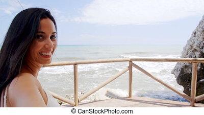 Brunette Woman Taking Self Portrait by Ocean - Smiling...