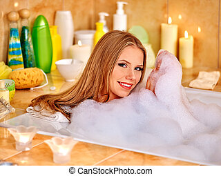 Woman taking bath with a lot of foam - Happy smiling woman...