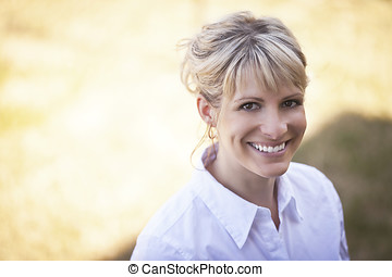 Portrait Of A Mature Woman Smiling - Yellow, Mother, Mature...