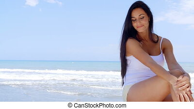 Portrait of Woman Sitting in Shade on Beach - Portrait of...