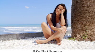 Woman Sitting Under Palm Tree at Tropical Beach - Woman with...