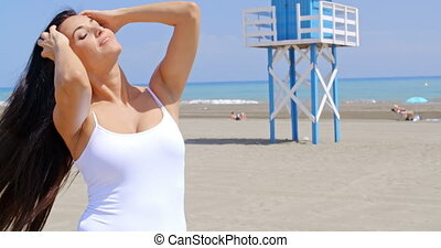 Brunette Woman Posing in front of Life Guard Stand - Smiling...