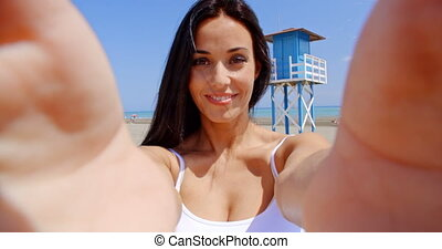 Brunette Woman Taking Self Portrait on Beach - Attractive...