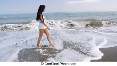 Woman Walking Along Shore of Tropical Beach - Full Length...