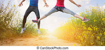 Young couple running - Young runners having fun in spring...