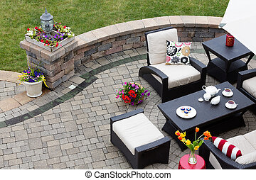 Brick paved patio with patio furniture - Brick paved patio...