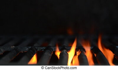 Flames on Grill Loop - Orange flames flare underneath a...