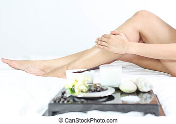 Female legs with spa composition