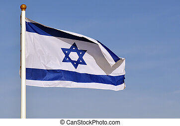 Flag of Israel against blue sky with copy space