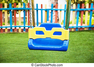 Empty swings for kids on the playground