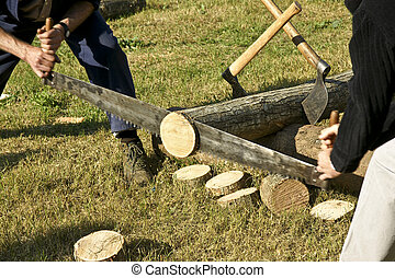 Woodcutter - Lumberjacks are cutting a wooden trunk