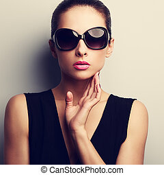 Sexy glamour female model in trendy sun glasses with hand at...