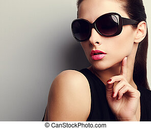 Elegant chic female model in fashion sunglasses posing -...