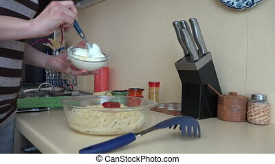 hand grate sauce pasta - Female hands put white sauce on...