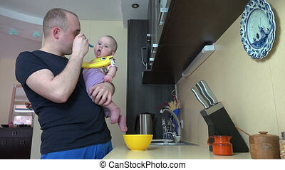 man feed baby girl - Careful father man talk with his...
