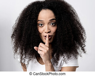 Shhh... silence please! - Young woman making a silence...