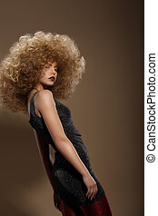 Haute Couture Fashion Woman with Fancy Hairstyle