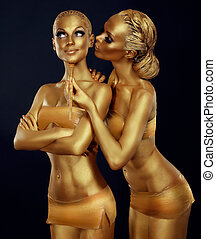 Bodypaint. Two Women Painted Gold. Carnival