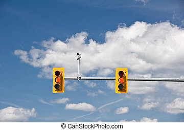 Traffic Lights and camera - A set of traffic lights turn...