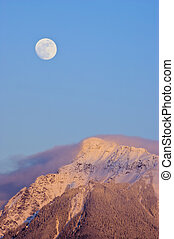 Moonrise - A full moon rises over Mt Cheam near Chilliwack,...