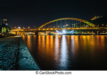 Fort Pitt Bridge at night, seen from Point State Park, in Pittsburgh, Pennsylvania.