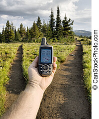 GPS at a Trail Junction - A GPS is used to decide which...