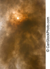 Smoke against the sun - Smoke and pollution bollow into the...