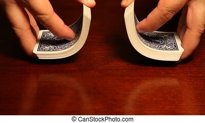 Hands shuffling cards - This is a video of some hands...