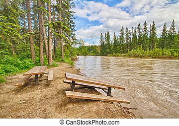 Flood Damaged Picnic Area - Damaged picnic area beside the...