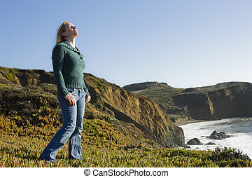 Woman Standing on Cliffside - Portrait of a Pretty Redhead...