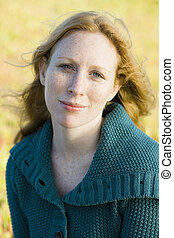 Woman Outdoors - Portrait of a Pretty Redhead Woman Outdoors