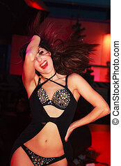 girl - beautiful girl dynamically moves on the dance field...