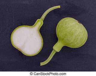 Halved bottle gourd,calabash gourd ,flowered gourd on wooden