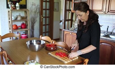 Woman In The Kitchen - Video clip of housewife in the...