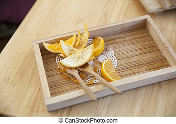 Orange peel on a wooden tray