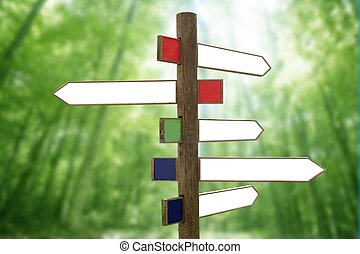 Crossroad wooden directional arrow signs copy space in green...