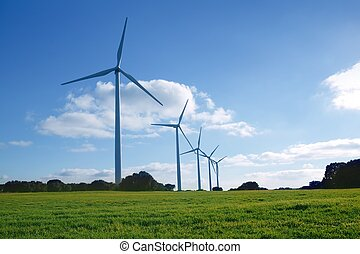Ecological electric energy windmills in meadow - Ecological...