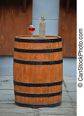 Wine standing on a wooden barrel - Rose wine standing on a...