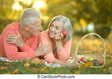 Amusing old couple - Portrait of amusing old couple on...