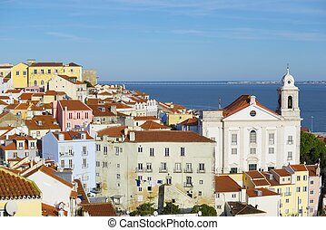 Alfama downtown and Santo Estevao Church in Lisbon,...