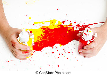 childrens hands and paint - Hands holding paint pots with...