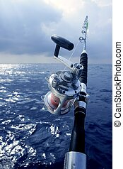 Big game boat fishing in deep sea on boat