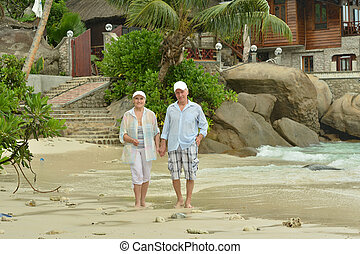 elderly couple standing embracing outdoors - Beautiful cute...