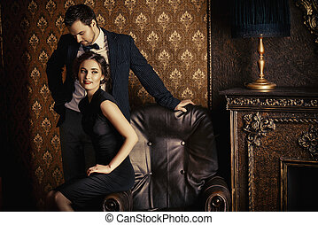 evening - Beautiful man and woman in elegant evening clothes...