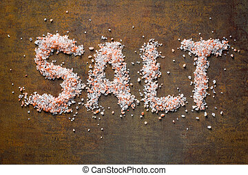 Himalayan salt on rusty background