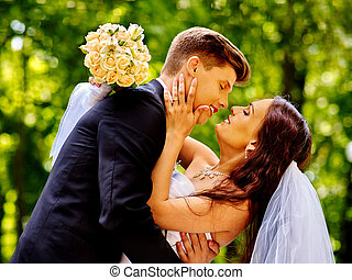 Groom kissing bride. - Happy wedding couple kissing bride...